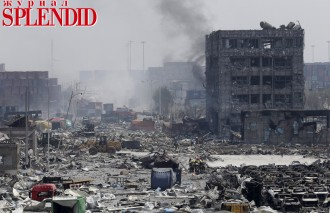 Smoke rise from the site of the explosions at the Binhai new district, Tianjin