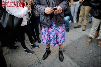 A man wearing a skirt takes part in a protest against domestic violence, in central Istanbul